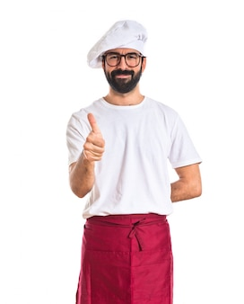 흰색 배경 위에 엄지 요리사