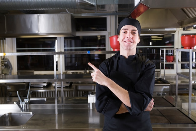 Chef with uniform in a kitchen