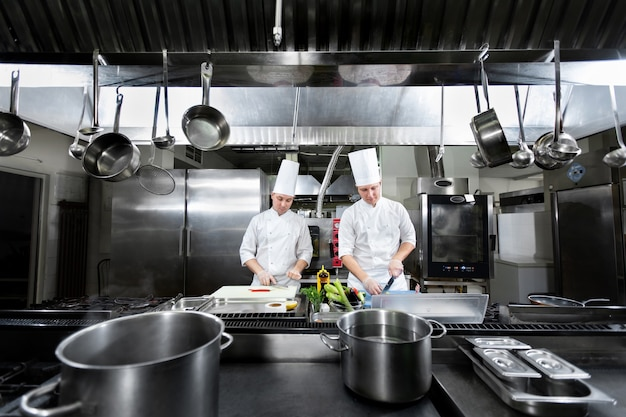 Chefs prepare meals in the kitchen