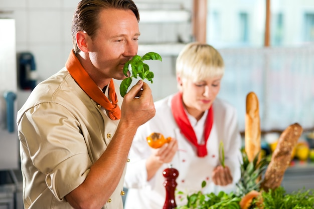 Chefs in a restaurant or hotel kitchen cooking