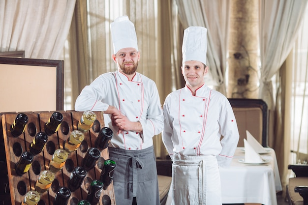 Chefs with wine bottles