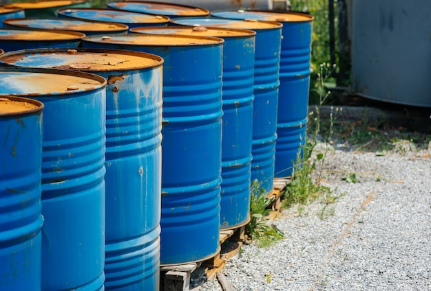 Chemical barrels in an open warehouse.