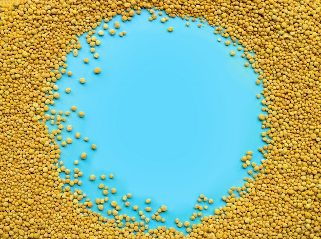 Chemical fertilizer for planting and plantation on blue background.