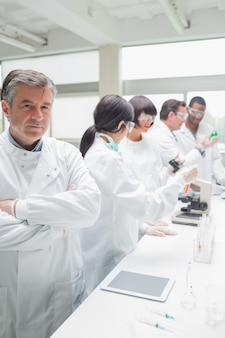 Chemist standing in front of tablet pc