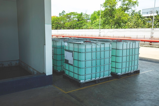 Chemistry white tank on pallets are storage in the warehouse factory to be packed