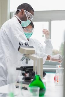 Chemists viewing liquids