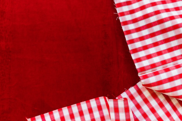 Chequered pattern fabric on burgundy textile