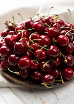 Cherries as background with shallow depth of field, bright and juicy cherry fruit, fruit texture