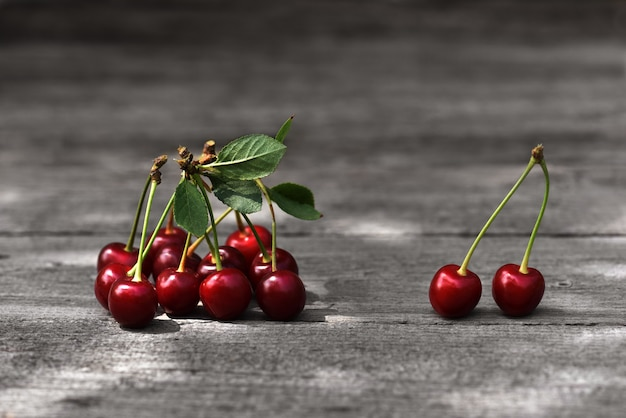 Cherries on vintage wooden surface.