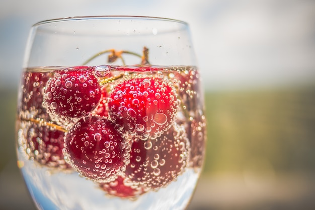 Cherries in water with bubbles.