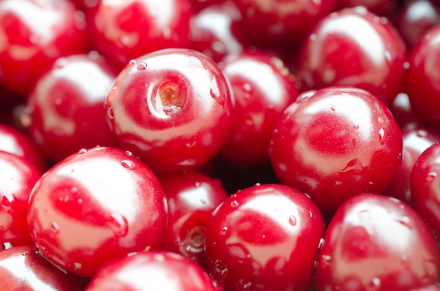Cherries with drops of water (as a fruit background)