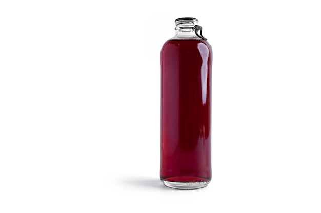 Cherry alcoholic drink in a bottle isolated on white.
