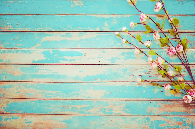 Cherry blossom flowers on vintage wooden background, border design. vintage color tone - concept flower of spring or summer background