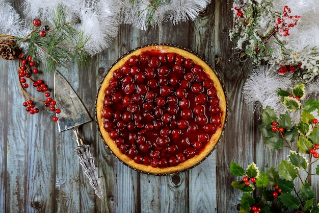 Cherry cheesecake with berries on the top with cristmas decoration