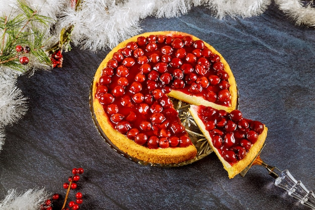 Cherry cheesecake with cherry jelly on the top with christmas decotation