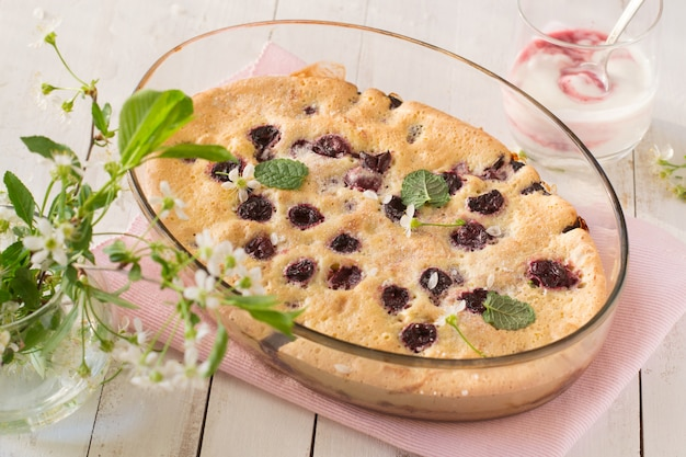 Cherry clafoutis on wooden table