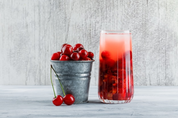 Cherry cocktail in a jug with cherries