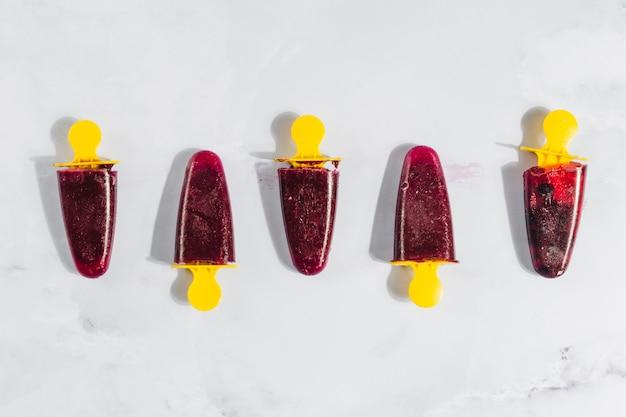 Cherry ice creams in row