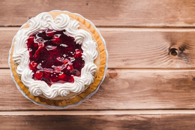 Cherry jam cake on wooden table