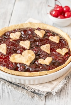 Cherry jam tart decorated with hearts, close-up