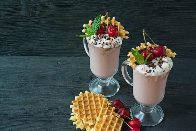 Cherry milkshake with ice cream and whipped cream