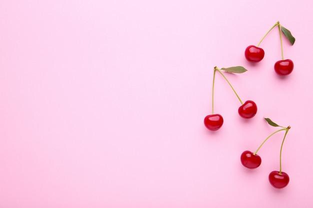 Cherry pattern. flat lay of cherries on pink.