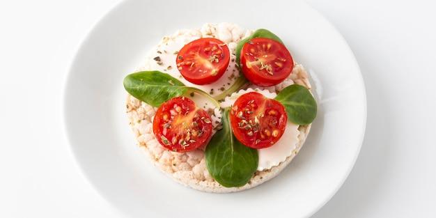Cherry tomato fruit snack on rice cakes