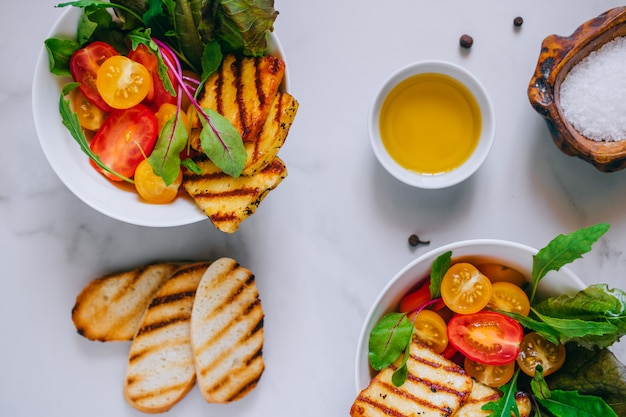 Cherry tomato salad with grilled haloumi cheese