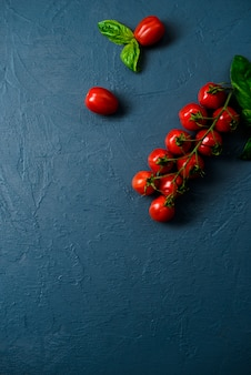 Cherry tomatoes over blue surface
