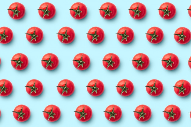 Cherry tomatoes on blue