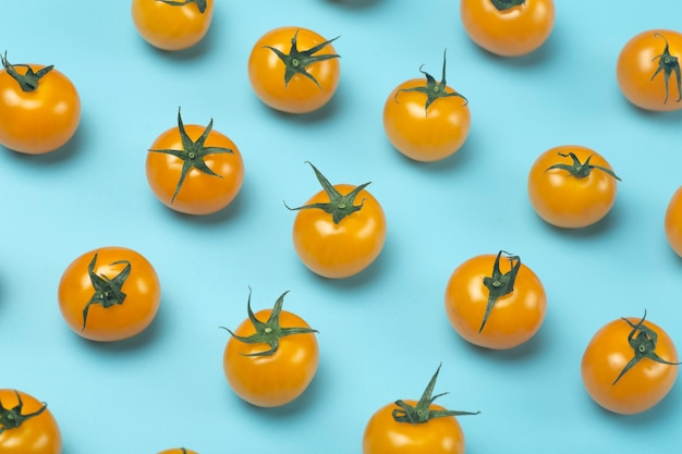 Cherry tomatoes on a colored blue background.