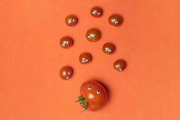 Cherry tomatoes concept with copy space. big hothouse tomato with eyes