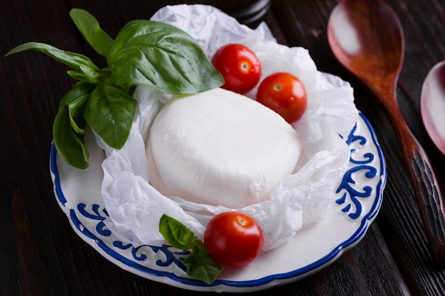 Cherry tomatoes and mozzarella on a plate