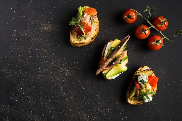 Cherry tomatoes near tartines