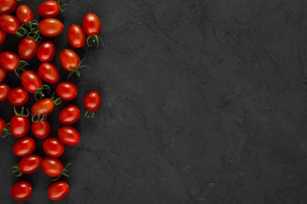Cherry tomatoes red ripe fresh on grey background