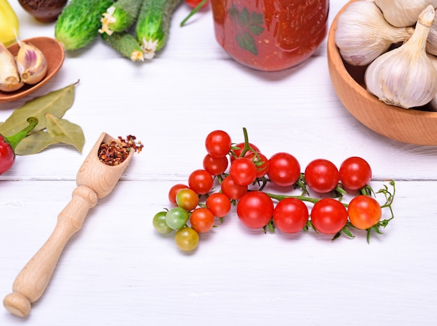 Cherry tomatoes and spoon with spices