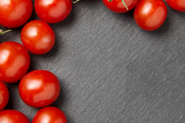 Cherry tomatoes over stone table.
