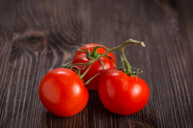Cherry tomatoes on a wooden table