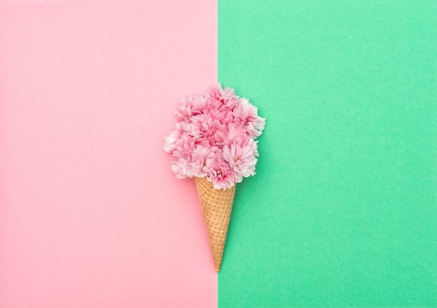 Cherry tree blossom ice cream waffle cone minimal flat lay