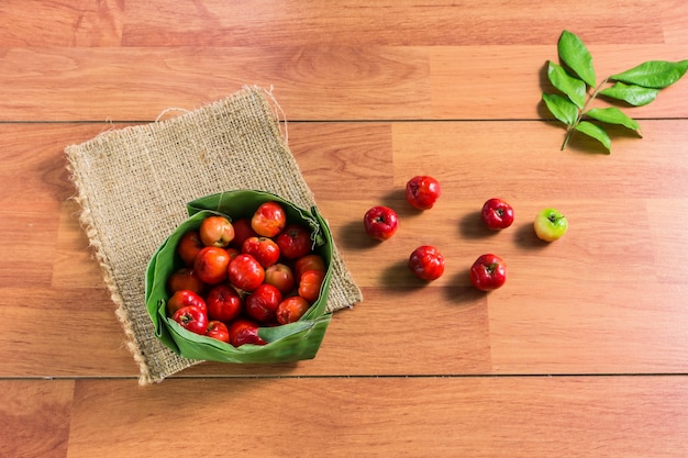 Cherry varieties in thailand in a banana leaf krathong placed on the brown wooden tables