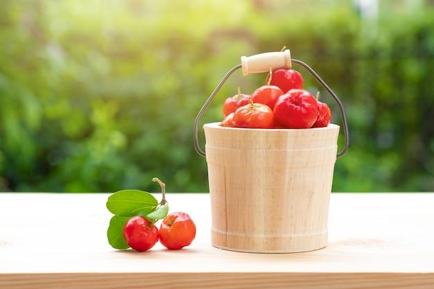 Cherry in wooden bucket