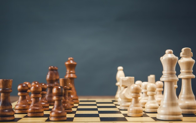 Chess on the board on the dark background