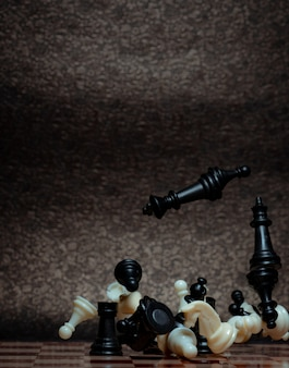 Chess board game. business strategy management and success concept. teamwork with competition and success strategic. chess clash, bounce off on a board. turn over chess board.