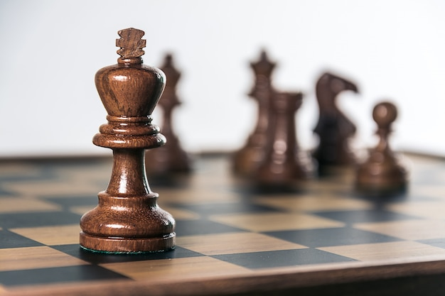Chess on board, white background