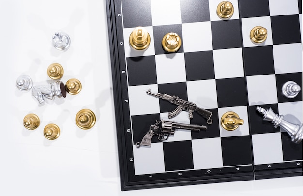 Chess board on white, golden and silver figures