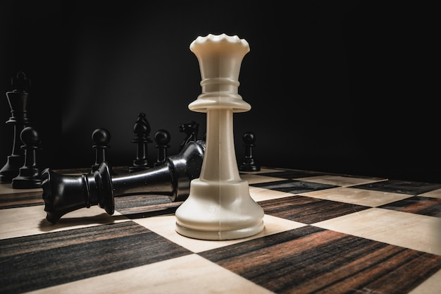 Chess board with figures on dark background