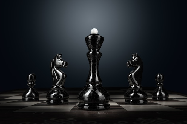 Chess board with figures on dark surface