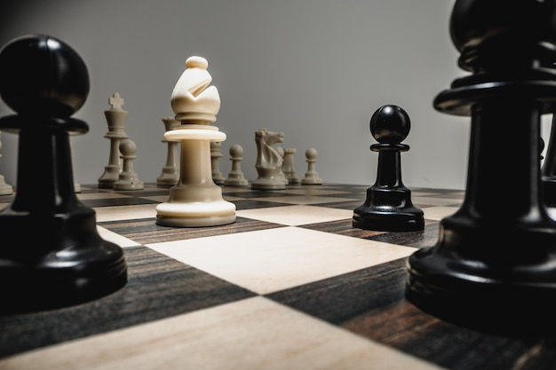 Chess figures on chess board macro photo