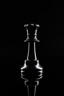Chess figures on dark black  close up