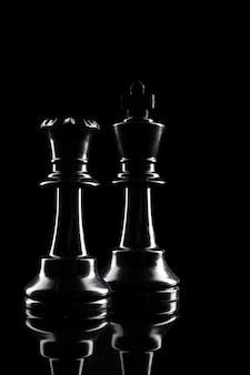 Chess figures on dark black